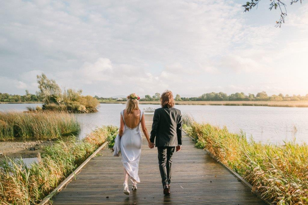 lakeside wedding jetty country house stylish wedding wedding dress groom