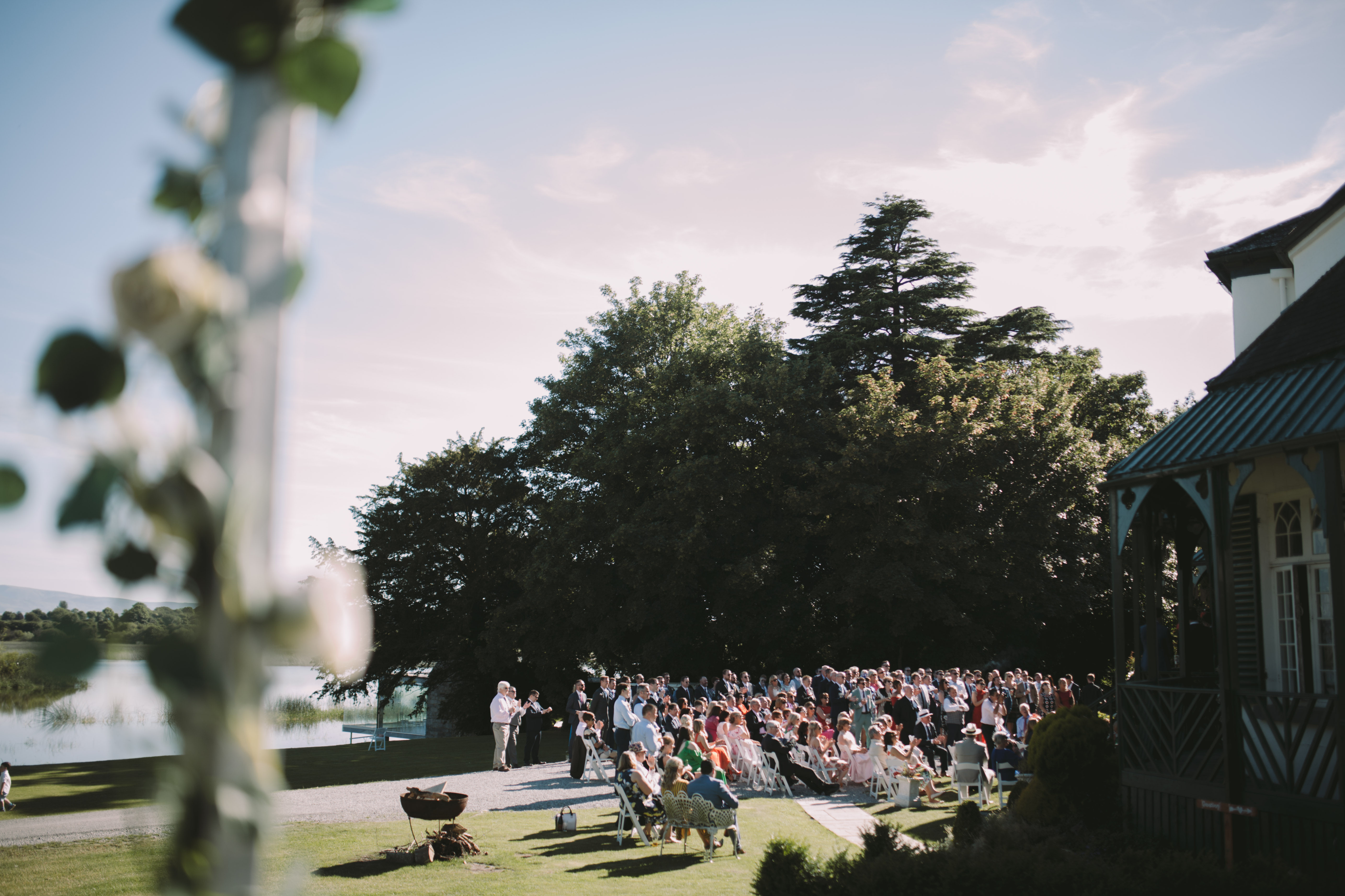 Wedding guests on lawn speeches on the lawn country house wedding Nenagh Tipperary Ireland