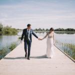wedding couple on lakeside jetty