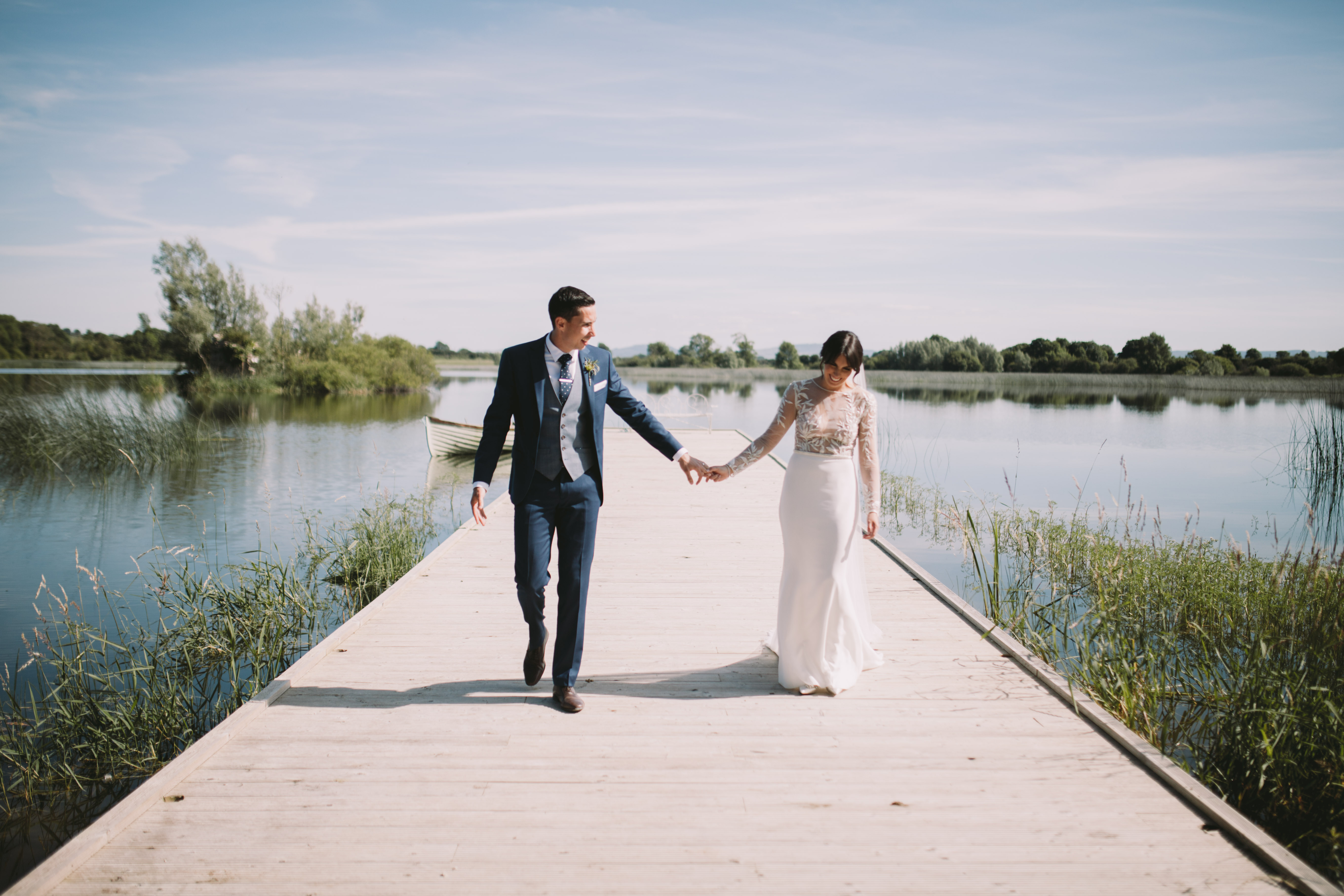 wedding couple on lakeside jetty